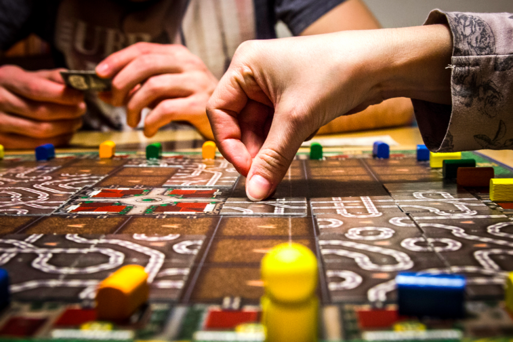 https://www.pexels.com/photo/board-game-fun-game-hands-84663/