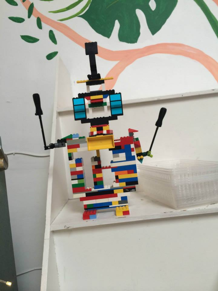 Lego robot at drink shop do