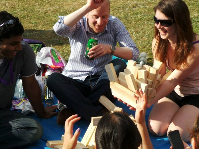 Playing jenga in the park: meet new friends at thinking bob