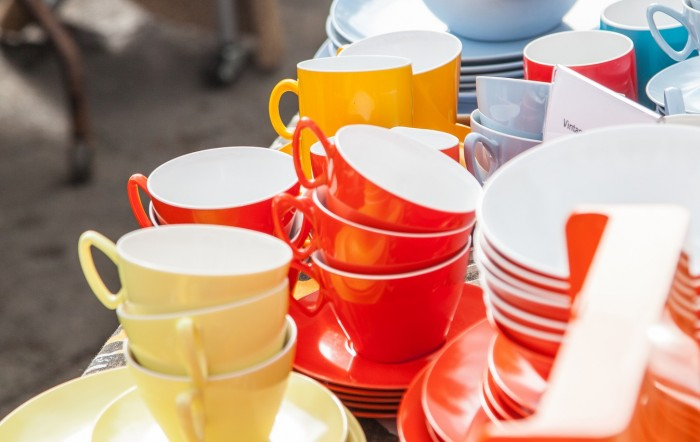 colourful cups at a car boot sale, uk
