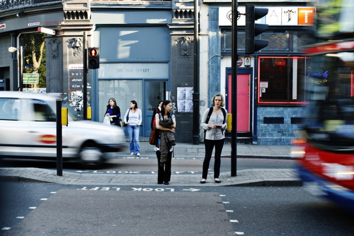 People crossing the road in Shoreditch, London